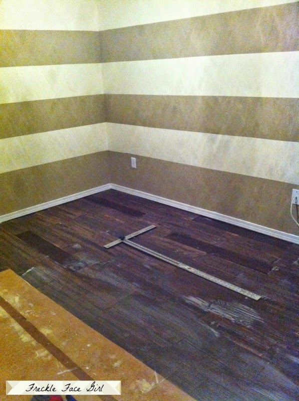 gluing-down-faux-wood-plank-floor-Freckle-Face-Girl-for-Remodelaholic-597x800