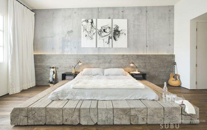 ρουστίκ κρεβάτι με μεγάλα οικοδομικά δοκάρια